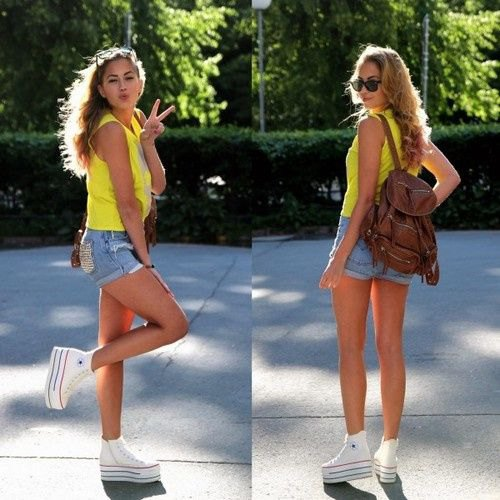 Lemon yellow tank top with blue denim shorts and white platform high-top sneakers