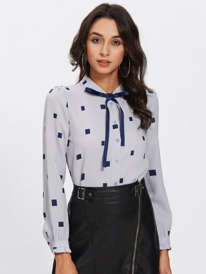 Light blue and dark blue printed leather skirt with tie neck blouse
