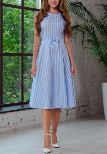 light blue and white midi flare dress with a plaid band and waist