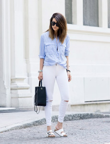 light blue and white striped shirt with buttons and ripped jeans