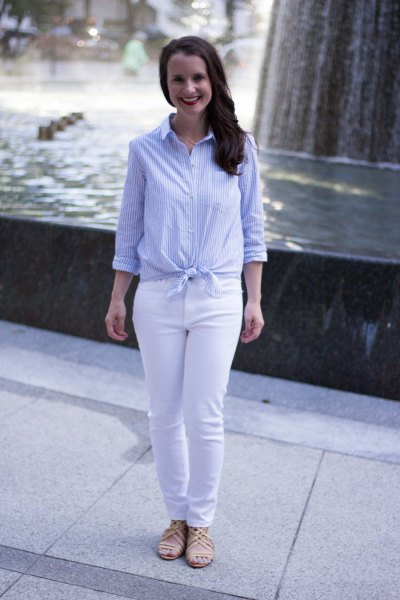 Light blue and white vertically striped knotted shirt with slim fit jeans