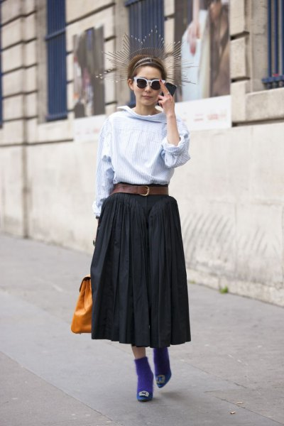 light blue blouse with black midi pleated skirt with belt