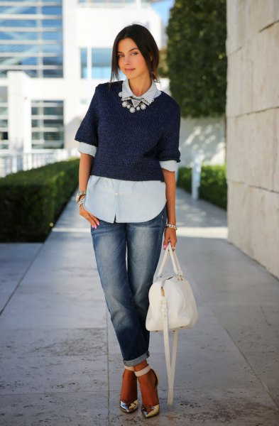 light blue blouse with dark blue short-sleeved sweater