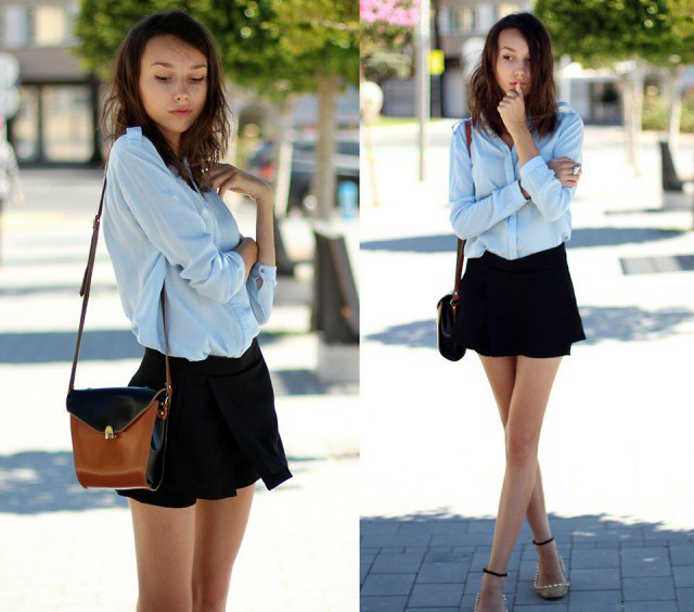 light blue chiffon blouse with button closure and black, flowing mini-shorts