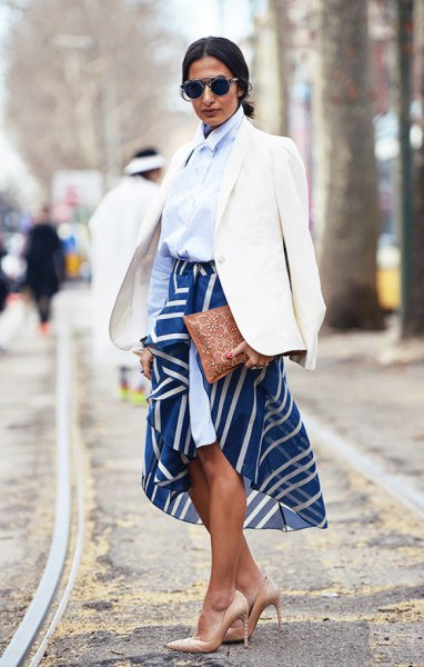 Light blue shirt with buttons and dark blue midi skirt