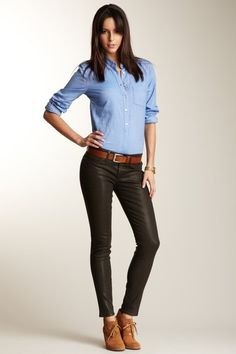 Light blue shirt with buttons and black, thinly waxed ankle jeans and boots