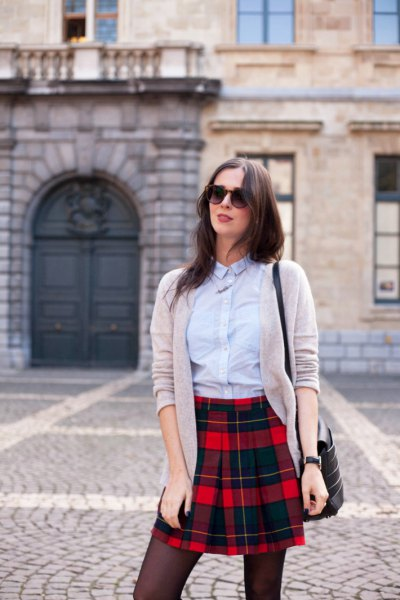 light blue shirt with buttons, gray cardigan and black checked mini skirt