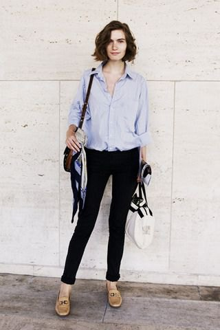 Light blue shirt with buttons, black skinny jeans and leather loafers