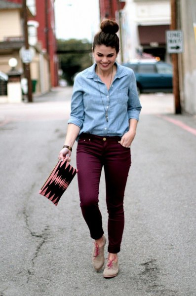 Light blue shirt with buttons and auburn slim fit jeans