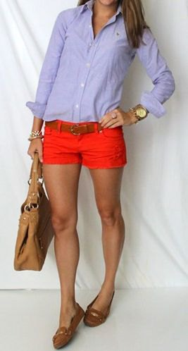Light blue shirt with buttons and red shorts with mini belt