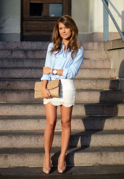 light blue shirt with buttons and white mini skirt with scalloped hem