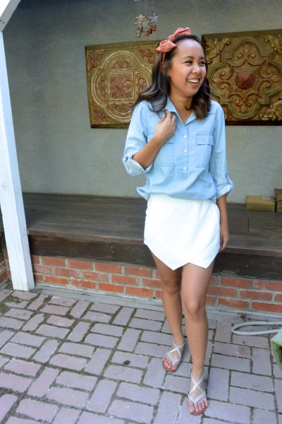 light blue shirt with button and white mini skirt