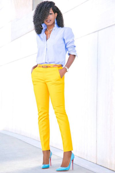 light blue shirt with buttons and yellow, narrow pants