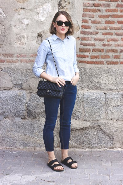 Light blue, narrow cut shirt with dark skinny jeans and dark blue sandals