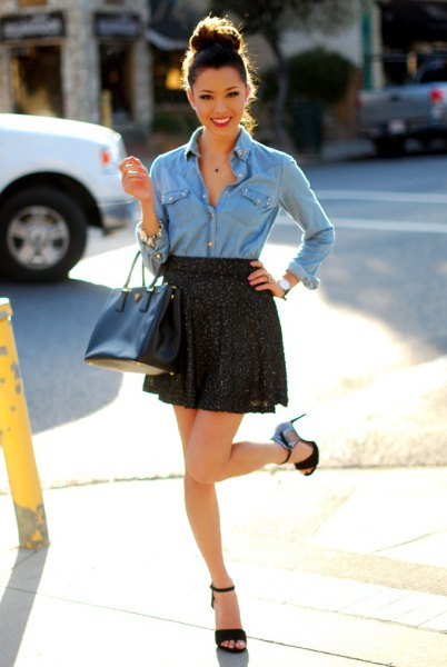 light blue chambray shirt with buttons and black mini skirt