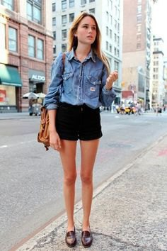 Light blue chambray shirt with buttons and black mini denim shorts
