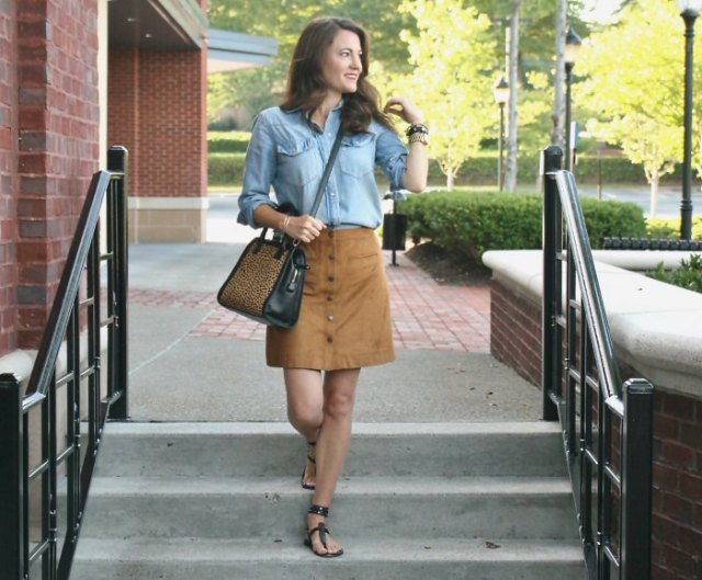 light blue chambray shirt with buttons, mini skirt and sandals