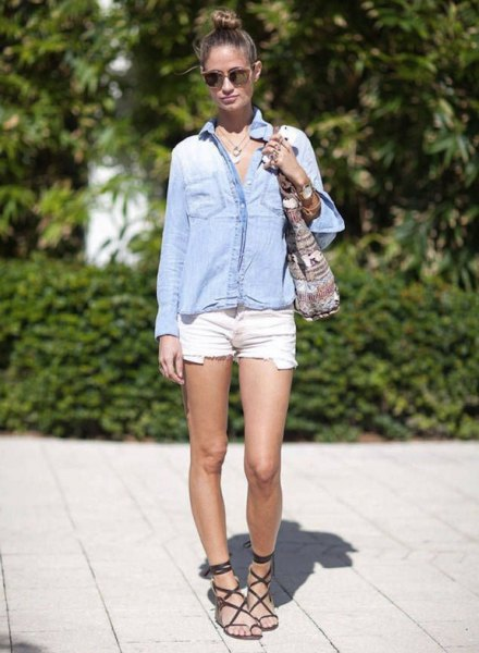 light blue chambray shirt with buttons and white mini shorts
