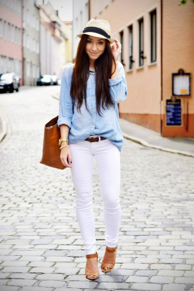 light blue chambray shirt with white skinny jeans and a straw hat