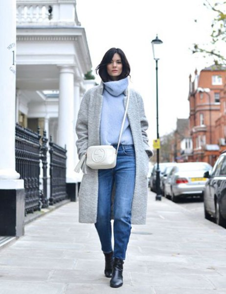 Light blue sweater with a cowl neckline, gray wool coat and jeans