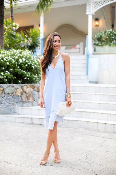 Light blue midi shift dress with a deep V-neckline and white heels with open toes
