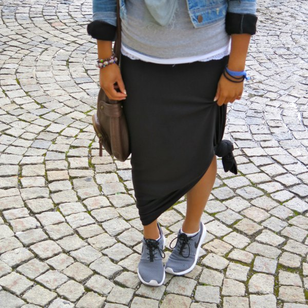Light blue denim jacket with a black knotted maxi travel skirt