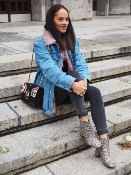 Light blue denim jacket with gray skinny jeans and printed boots