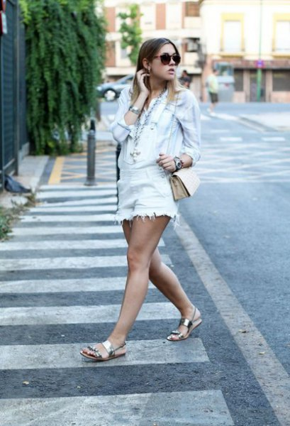 Light blue denim jacket with white denim overalls and silver sandals