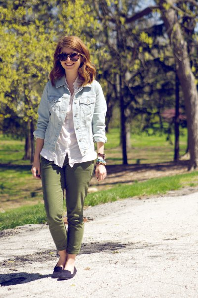 Light blue denim jacket with white linen blouse and green slim fit trousers