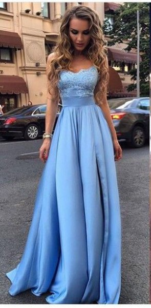 Light blue fit and a flared evening dress made of lace and silk