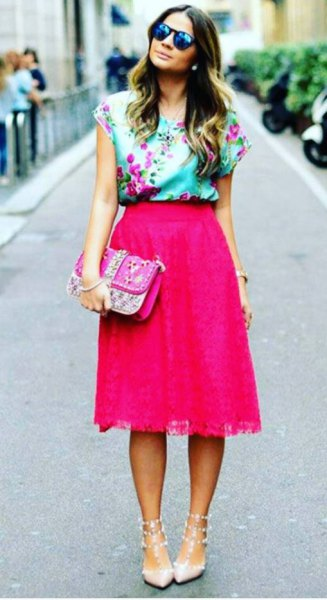 Light blue sleeveless silk blouse with floral print and pink midi skirt