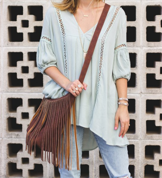 Light blue tunic top with V-neck and V-neck and small cutouts