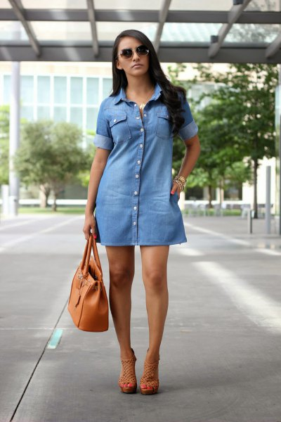 light blue denim dress with brown leather handbag
