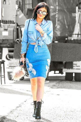 Light blue, knotted chambray shirt with a figure-hugging mini ripped skirt