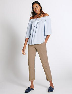 Light blue strapless blouse with beige, narrow-cut chinos