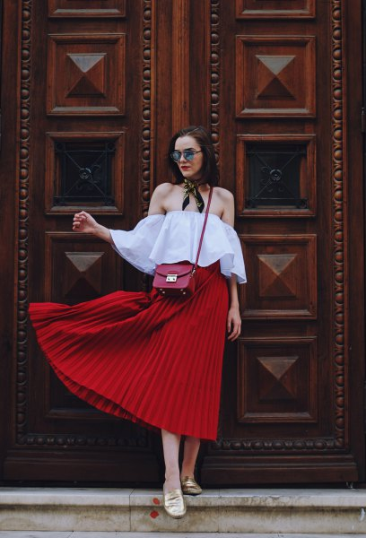 light blue strapless blouse with red pleated midi skirt