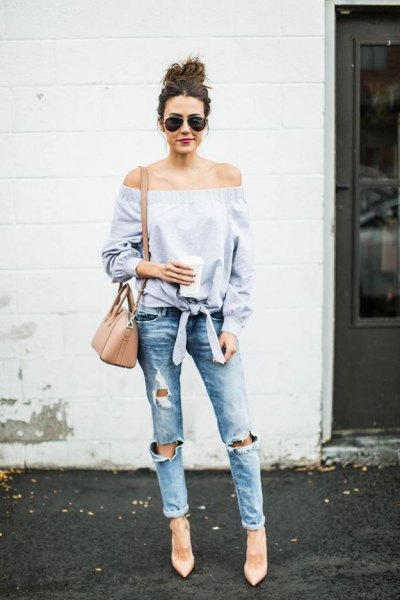 Light blue, off-the-shoulder, knotted blouse with ripped boyfriend jeans