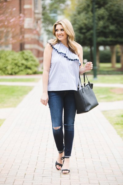 Light blue sleeveless top with a shoulder ruffle and skinny jeans
