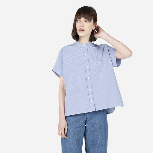 light blue oversized collarless short sleeve shirt