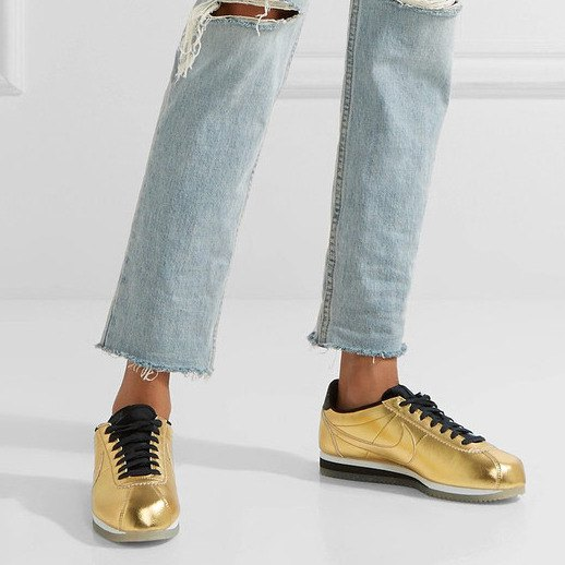 Light blue, torn tube pants with golden, comfortable hiking shoes