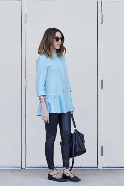 light blue blouse with frilled hem and black leather gaiters