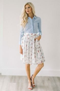 light blue shirt with white pleated skirt made of chiffon with floral pattern and pockets