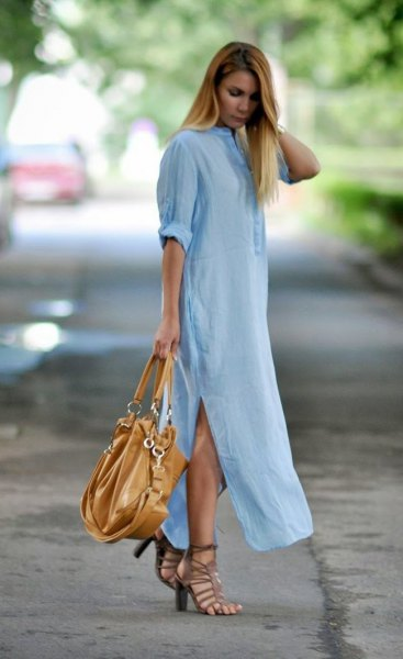 Light blue maxi shirt dress with side slit and black leather handbag