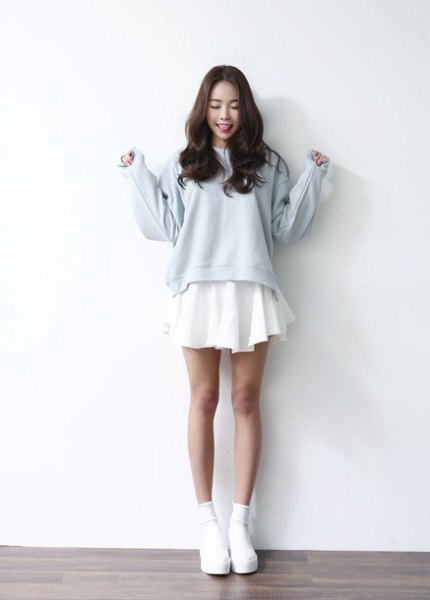 light blue sweater over white mini hangover dress