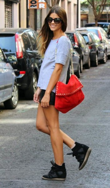 Light blue t-shirt with denim shorts and black wedge sneakers
