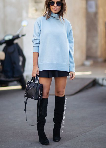 Light blue turtleneck with a black mini skirt and boots