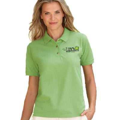 light green embroidered polo shirt with white chinos