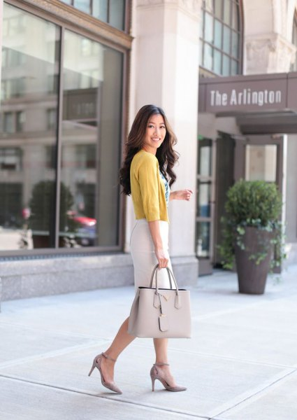 light green cardigan with half sleeves and white pencil skirt