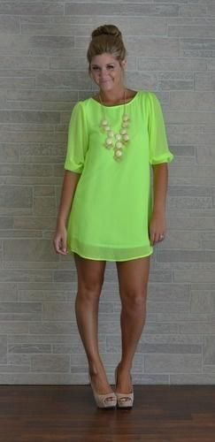 light green mini shift dress with half sleeves and pink heels