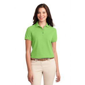 light green polo shirt with ivory-colored skinny jeans